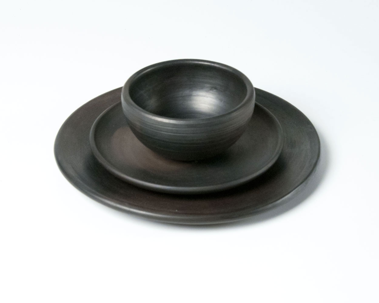 Latvian black pottery set by beate snuka in collaboration with Latgalian potters